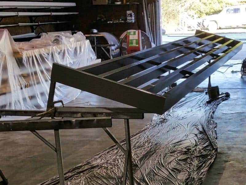 Custom aluminum sunshade built in our fabrication shop. We build our own welded frames for superior quality and long life.